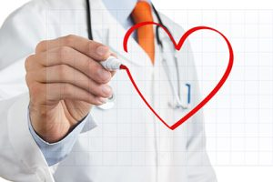 Male doctor drawing heart symbol at the whiteboard